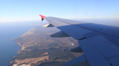Plane flying over sea coast Stock Footage