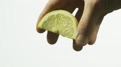 Squeezing lemon Stock Footage