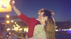 Beauty happy young couple dating, taking picture of beautiful night city Stock Footage
