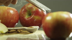 Zesting cinnamon sticks over apples Stock Footage