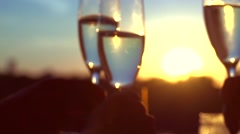 Group of people toasting and drinking champagne over sunset. Arkistovideo