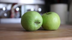 Green apples on kitchen table, slider shot Stock Footage