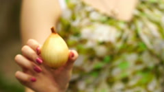 Footage Woman holding a onion close up Stock Footage