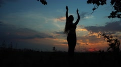Silhouette Female Girl is Doing Yoga Background Red Sunset Sky Stock Footage