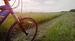 Perspective Clip of a Mountain Bike Tire Riding over Muddy Terrain Stock Footage