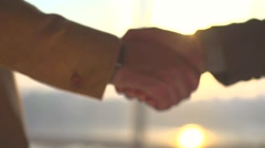 Businessmen shaking hands in the office, closeup. Good deal, business concept. Stock Footage