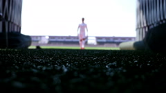 Silhouette of a football player leaving the field of the stadium, slow motion Stock Footage