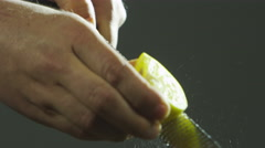 Grating lemon zest Stock Footage