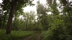 Cross Country Cycling over Muddy Terrain on a Cloudy Day. Video 4k Stock Footage