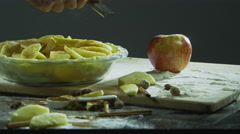 Grating cinnamon onto sliced apples to make apple pie Stock Footage