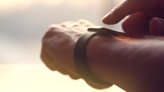 Young man making gestures on a wearable smart watch Stock Footage