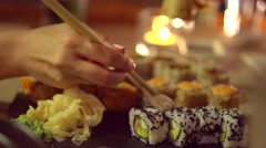 Happy couple eating sushi rolls in japanese restaurant Stock Footage