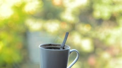 Evaporation from a mug of hot coffee with a spoon.  Stock Footage