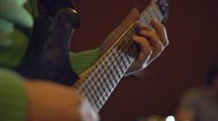 Man playing guitar, rock band rehearsal. Guitar closeup Stock Footage