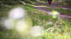 Woman riding a mountain bicycle Stock Footage
