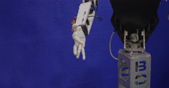 In Moscow, Russia on exhibition Robotix expo robot with arm shakes hands with Stock Footage