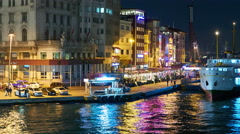 View of docks at night from the Galata Bridge Stock Footage