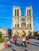 PARIS, FRANCE - APRIL 6, 2011: the French walk in front of Cathedral Notre Da Stock Photos