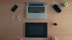 Top view designer man or illustrator uses his graphics tablet and laptop Stock Footage