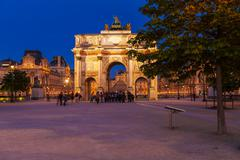 PARIS, FRANCE - APRIL 6, 2011: People walking in front of Arc de Triomphe and Stock Photos