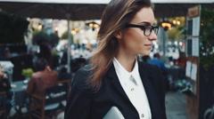 Outdoor portrait of young beuatiful businesswoman Stock Footage