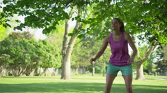 Slow motion girl catching frisbee Stock Footage