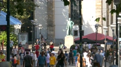 4K Alfred Krupp statue Downtown Essen pedestrian commuters walking street in Stock Footage