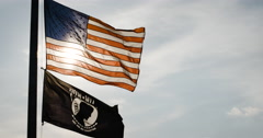 American POW flag blowing in the wind - 4k Stock Footage