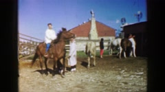 1961: grandma rides a horse on a beautiful sunny day at the ranch IOWA Stock Footage