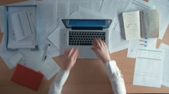 Top view businessman working at office desk with his laptop secretary brings Stock Footage
