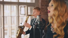 Jazz vocalist perform on stage with saxophonist. Song. Musicians. Live concert Stock Footage