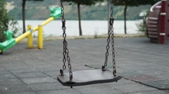 Loneliness empty swing on park Stock Footage