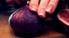 Woman cutting ripe fig 4K close up shot Stock Footage