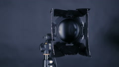 Professional spotlighs, studio lights for FilmMaking, tv production on a black Stock Footage
