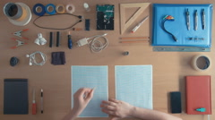 Top view industrial designer engineer drawing sketches of his project Stock Footage