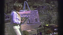 1961: children attend a painting class in the park. IOWA Stock Footage