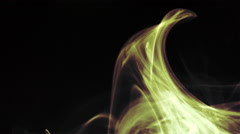 Colored curl, wave of smoke on black background - Yellow Stock Footage