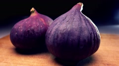 Whole ripe figs on cutting board. 4K close up pan shot Stock Footage