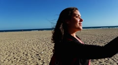 Cool shot of woman taking a selfie by beautiful beach in California Stock Footage