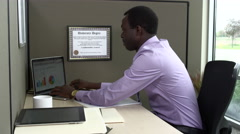 Portrait of african american businesman typing on laptop Stock Footage