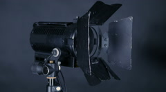 Professional spotlighs, studio lights for FilmMaking, tv production on a black Stock Footage