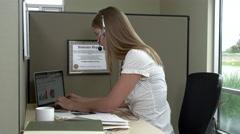 Telemarketer typing on laptop Stock Footage