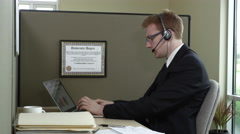 Portrait of Telemarketer using laptop Stock Footage