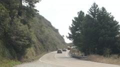 Cars Traversing A Hillside Road Stock Footage