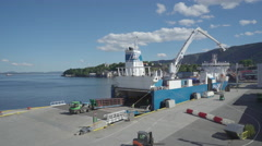 Truck loading a cargo ship in the port Stock Footage