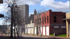 Abandoned buildings line a street in a rundown area of Jackson, Mississippi. Stock Footage
