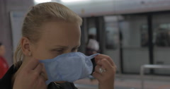 In Hong Kong, China in subway a young girl wears a medical mask Stock Footage