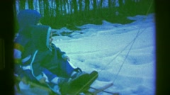 1961: dudes glide on ice. IOWA Stock Footage