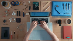 Top view software engineer is developing program coding on his laptop computer Stock Footage