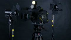 Camcorder, video camera and professional studio lights in a broadcasting studio Stock Footage